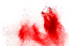 Freeze motion of red powder exploding, isolated on white background. Abstract design of red dust cloud. Particles explosion screen saver, wallpaper stock image