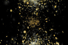 Freeze motion of shiny yellow golden particles exploding scatter Royalty Free Stock Images