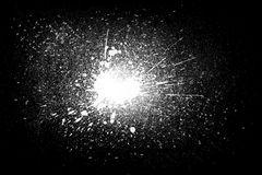 Freeze motion of white powder exploding shatter splatter. Freeze motion of white powder exploding, isolated on black, dark background. Abstract design of white Stock Images