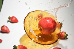 Apple and water Freeze Time With a Fast Shutter stock image
