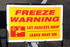 Freeze warning sign. Advice to residents to protect against the freezing temperatures stock image
