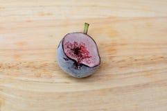 Freezer half Figs fruits. On wood background Stock Images
