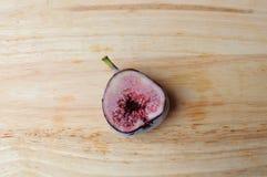 Freezer half Figs fruits. On wood background Royalty Free Stock Image
