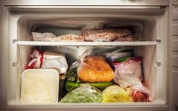 Freezer interior. Various frozen food in freezer, illuminated details Royalty Free Stock Photo