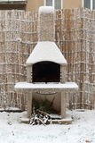 Freezing Chimney. Outdoor chimney fireplace covered by snow in winter time Stock Photos