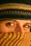 Freezing Cold. Woman with hat and scarf royalty free stock photos