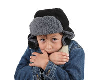 Freezing cold young boy. Boy freezing in the winter cold wearing wool hat and jacket on white background Stock Photos