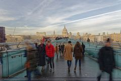 Crowds on Millennium Bridge, with St Pauls in the background. London royalty free stock image