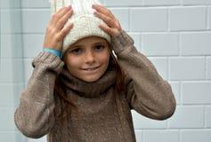 Freezing girl with bobble hat. Freezing girl with new white bobble hat Stock Images