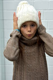 Freezing girl with bobble hat Royalty Free Stock Photos