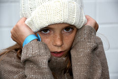 Freezing girl with bobble hat Stock Images