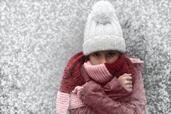 Freezing girl. With bobble hat and scarf outside in snow Stock Photography