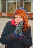 The freezing girl with red hair Royalty Free Stock Image