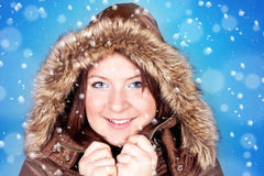 Freezing girl and snowflakes Stock Photography
