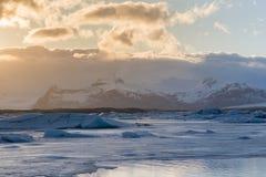 Freezing ice lake with sunset tone background Stock Image
