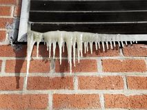 Freezing ice on vent. Sub freezing temperatures across much of the US due to the polar vortex. Unseasonably cold chill winter weather. Iciles formed as stock photos