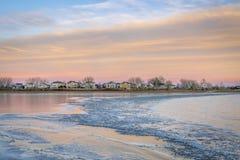 Freezing lake after sunset royalty free stock photography