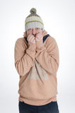 Man with cap and scarf freezing Stock Photos