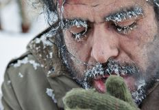 Freezing Man Snow Winter. A close-up portrait of a freezing man, homeless, refugee, outdoors in a cold winter weather Stock Photos