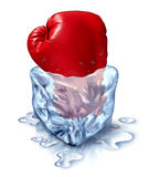 Freezing Out The Competition. Business concept as a red boxing glove in an ice cube as a metaphor for chilling out with a fresh competitor icon or frozen Royalty Free Stock Photo