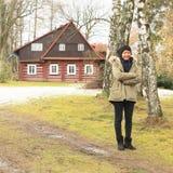 Freezing Papuan girl at timbered mountain cottage Royalty Free Stock Image
