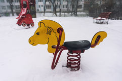Freezing playground. Playground freezing in a heavy winter snowfall Stock Images