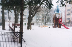 Freezing playground. Playground castle with slide freezing in a heavy winter snowfall Royalty Free Stock Photos