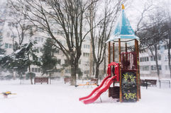 Freezing playground castle. Playground castle with slide freezing in a heavy winter snowfall Royalty Free Stock Images