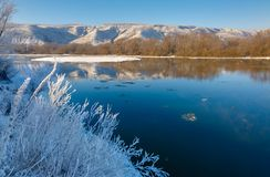 Freezing river from hilly banks and large ice floes. Freezing river from the hilly banks and large ice floes Stock Images
