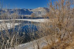 Freezing river from the hilly banks and large ice floes. A sunny. Day with a cloudless sky Stock Image