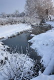 Freezing river with snow cover Stock Photography