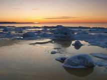 Freezing sea shore in the romantic evening light Royalty Free Stock Images