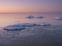 Freezing sea shore in the romantic evening light Royalty Free Stock Photography