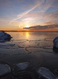 Freezing sea shore in the romantic evening light Stock Photography