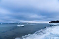 Freezing seashore in the dusk Stock Photo