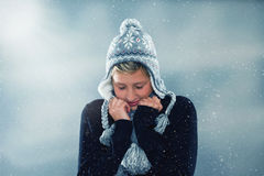 Freezing in snowstorm Stock Images
