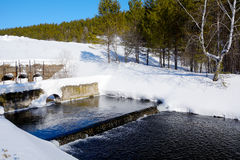 Freezing spillway on the pond Stock Photo