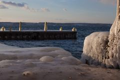Ice on the Dock at Wells College. Freezing temperatures plus a viscous northwest wind coat everything next to Cayuga Lake in ice stock photography