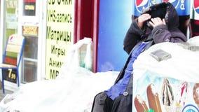 Freezing vagrant on street stock video footage