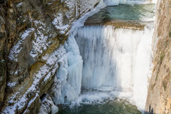 Freezing waterfall in gorge Royalty Free Stock Images