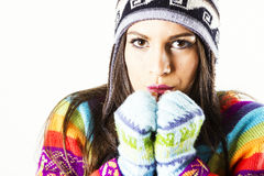 Freezing winter woman portrait. Freezing young winter woman portrait with gloves, hat and colored sweater Royalty Free Stock Images