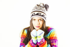 Freezing winter woman. Freezing young winter woman with gloves, hat and colored sweater Royalty Free Stock Images