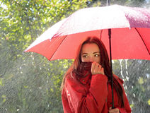 Freezing woman in rain Stock Photos
