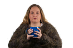 Freezing woman with tea cup Stock Image