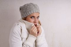 Freezing woman Stock Images