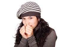 Freezing young woman. In hat isolated on white background Royalty Free Stock Image