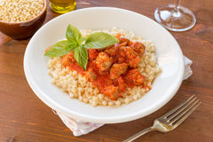 Fregola with tomato sauce and sausage Stock Photography
