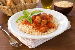 Fregola with tomato sauce and sausage Royalty Free Stock Photos
