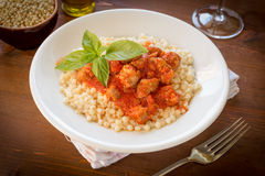 Fregola with tomato sauce and sausage Stock Photos