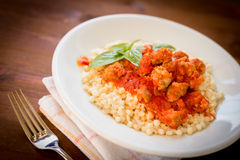 Fregola with tomato sauce and sausage Royalty Free Stock Images